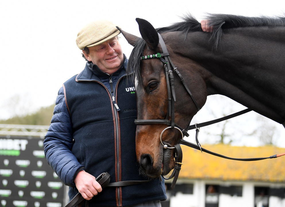 Nicky Henderson poses with Altior at his annual Cheltenham media day at Seven Barrows.